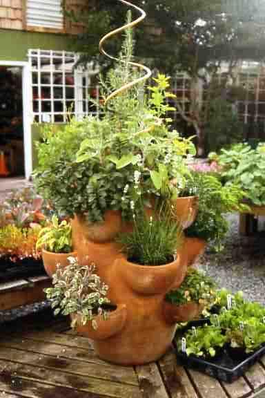 http://gardenwithpassion.com/tower-herb-garden/