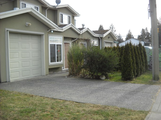 From this angle you can see the tiny entry path, but from right in front it's just a lot of tall grass and cedar hedging.